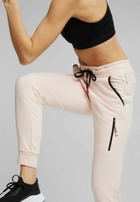 Esprit Sports - Tracksuit bottoms - peach - 4