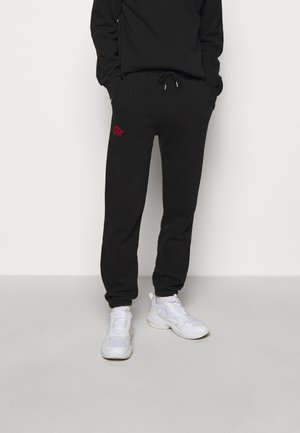 Pantalon de survêtement - faded black/red