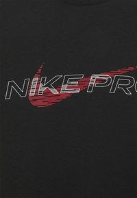 Nike Performance - TEE PRO - Print T-shirt - black - 2
