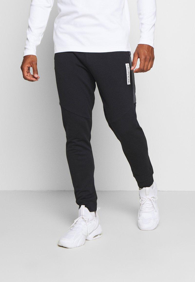 Calvin Klein Performance - PANTS - Teplákové kalhoty - black