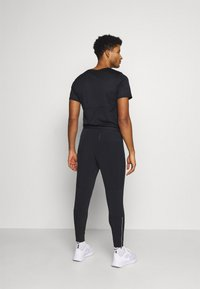 Nike Performance - ELITE PANT - Pantalon de survêtement - black/black - 2