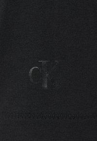 Calvin Klein Jeans - SEASONAL MONOGRAM TEE UNISEX - Print T-shirt - black - 7