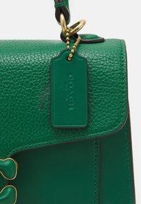 Coach - COVERED CLOSURE TABBY TOP HANDLE - Handbag - green - 3