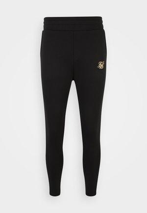 EXPOSED TAPE JOGGERS - Pantaloni sportivi - black/gold