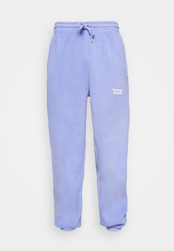 CORE OVERDYE  - Tracksuit bottoms - purple