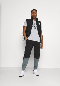 adidas Originals - SLICE - Tracksuit bottoms - black/blue oxide - 1