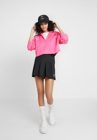 Puma - CLASSICS PLEATED SKIRT - A-line skjørt - black - 1