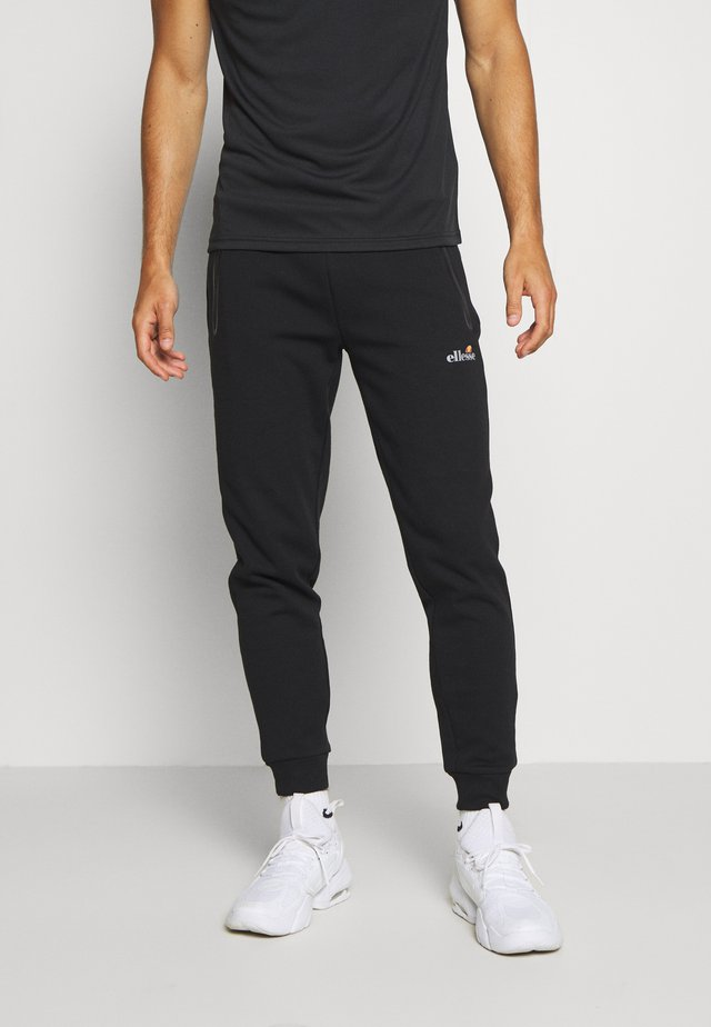 OSTERIA - Tracksuit bottoms - black