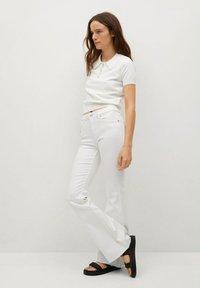 Mango - FLARE - Flared Jeans - white - 3