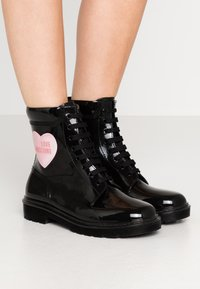 Love Moschino - RAIN LOVE - Lace-up ankle boots - black - 0