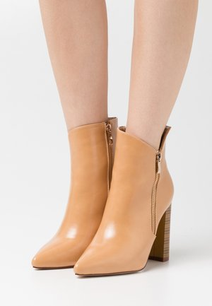 KEYLA - High heeled ankle boots - beige