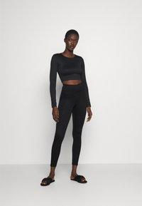 Gina Tricot - YARA LEGGINGS - Pyjama bottoms - black - 1