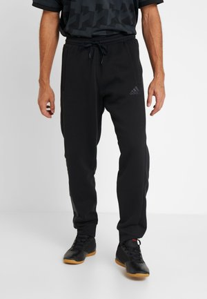 TAN  - Tracksuit bottoms - black