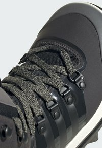 adidas by Stella McCartney - EULAMPIS MACCARTNEY OUTDOOR REGULAR SHOES MID - Winter boots - black - 7
