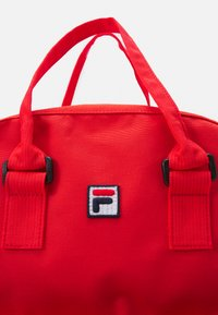 Fila - COATED CONVERTIBLE MID BACKPACK UNISEX - Rucksack - true red - 3