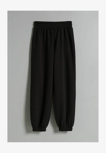 PLÜSCH - Pantaloni sportivi - black