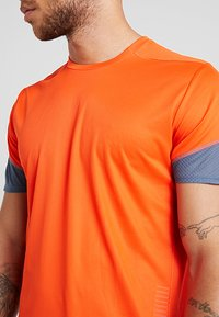 adidas Performance - TEE  - Print T-shirt - orange - 5