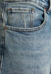 ONLY Carmakoma - CARENEDA MOM - Straight leg jeans - light blue denim - 4