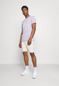 Nike SB - SUNDAY UNISEX - Tracksuit bottoms - coconut milk/light dew - 1