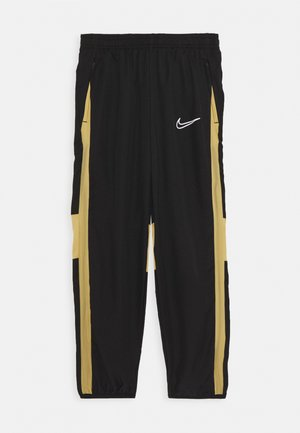 DRY ACADEMY  - Tracksuit bottoms - black/jersey gold/white