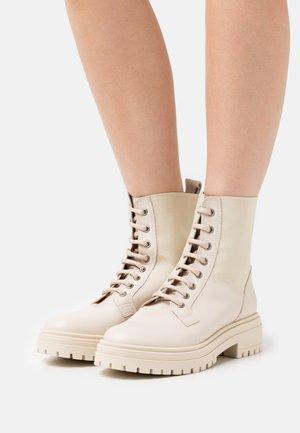 Platform ankle boots - avorio