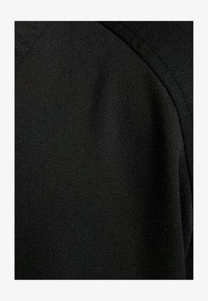 Kauluspaita - black