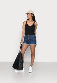 ONLY Petite - ONLHUSH BUTTON PETIT - Denim shorts - dark blue denim - 1