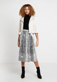 Ibana - Leather jacket - white - 1