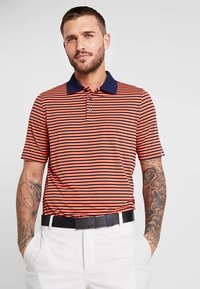 Kjus - MEN LUIS STRIPE - Polo - intensive peach - 0