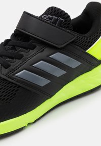 adidas Performance - FORTAFAITO KIDS NEXT SPORTS RUNNING SHOES - Neutral running shoes - core black/grey four/signal green - 5