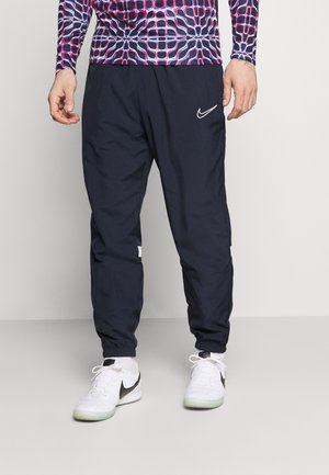 PANT - Tracksuit bottoms - obsidian/white
