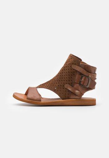 CAROLINA  - Ankle cuff sandals - brown