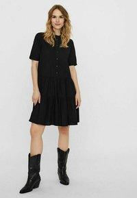 Vero Moda - STEHKRAGEN - Shirt dress - black - 1