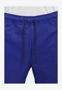 Nike Sportswear - Tracksuit bottoms - deep royal blue/black - 5