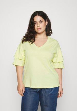 FRILL - Print T-shirt - lemon