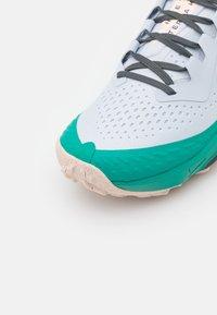 Nike Performance - AIR ZOOM TERRA KIGER 7 - Trail running shoes - football grey/black/ghost/iron grey/neptune green/crimson tint - 5