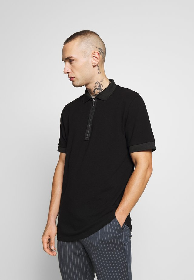 TONAL - Polo - black