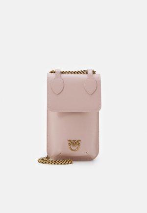 IXIA PHONE HOLDER SIMPLY - Across body bag - cipria