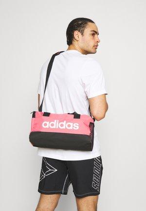 LINEAR DUF XS UNISEX - Sportovní taška - hazy rose/black/white
