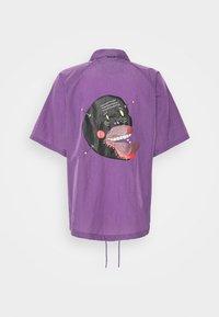 Grimey - LIVEUTION SHORT SLEEVE COACH JACKET UNISEX - Summer jacket - purple - 1
