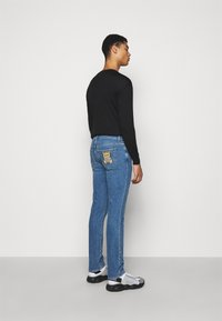 MOSCHINO - TROUSERS - Slim fit jeans - blue - 2