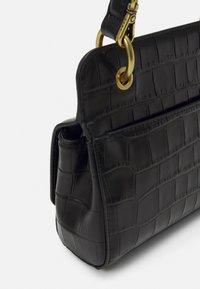 DKNY - COOPER FLAP XBODY CROCO - Handbag - black/gold-coloured - 4