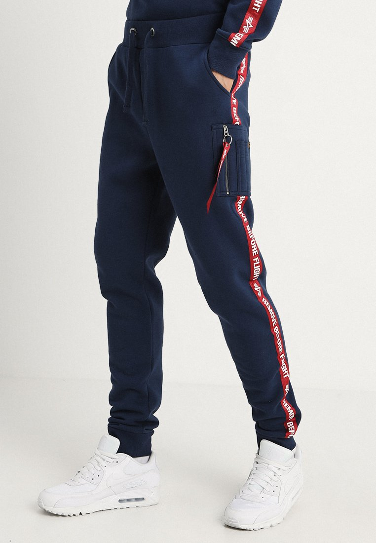 Alpha Industries - JOGGER TAPE - Tracksuit bottoms - new navy