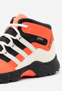 adidas Performance - TERREX RELAXED SPORTY GORETEX MID SHOES - Hiking shoes - core black/core white/solar red - 5