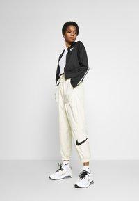 Nike Sportswear - PANT - Trainingsbroek - fossil/black - 1
