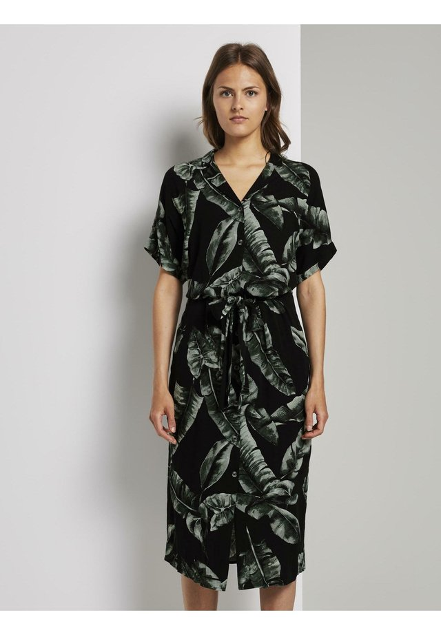 Blousejurk - black tropical leaves design