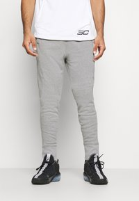 Under Armour - JOGGER - Tracksuit bottoms - pitch gray light heather - 0