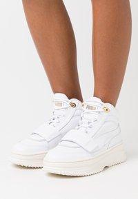 Puma - DEVA  - High-top trainers - white/marshmallow - 0