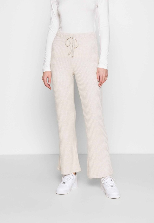 BRUSHED - Trousers - oat