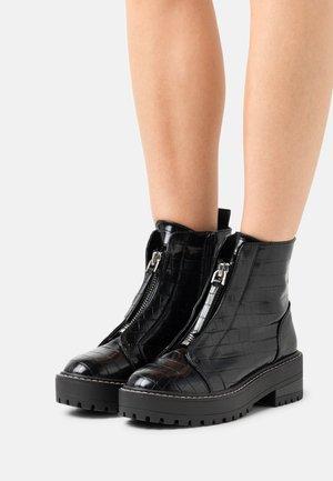 ZIP BOOT - Enkellaarsjes met plateauzool - black